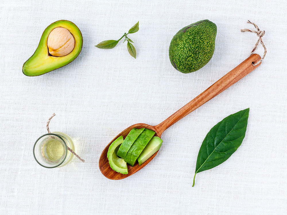 Sliced avocado and avocado oil