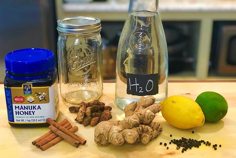 Ginger, Turmeric, Cinnamon, Black peppercorns, manuka honey, lemon, lime, water, ball jar