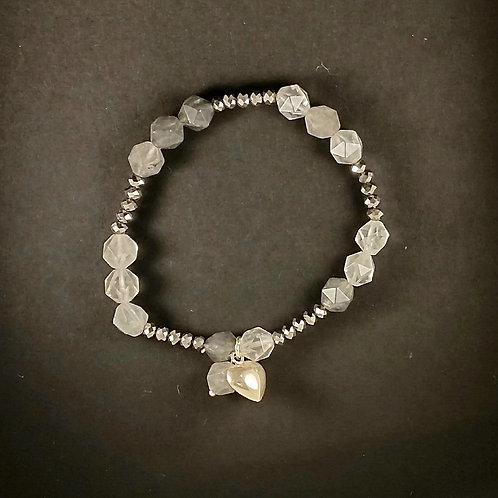 Silver heart in white quartz