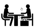 2 people at table.png
