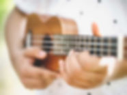 musician-playing-ukulele-guitar-gm545786