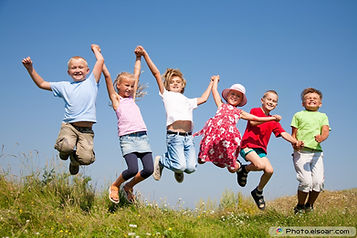 Group-happy-children-jumping-on-summer-m