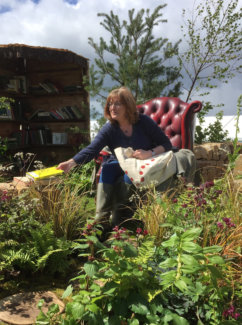 Janice reading in the garden