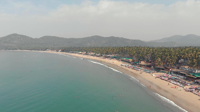 long-sand-stretch-of-palolem-beach-tranquil-turquoise-sea-waters-goa-india-video.jpg