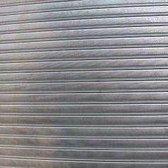 Serranda avvolgibile in elementi microforati zincati