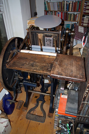 A photograph of my Arab treadle platen press in the process of printing a new edition of 'Tea'.