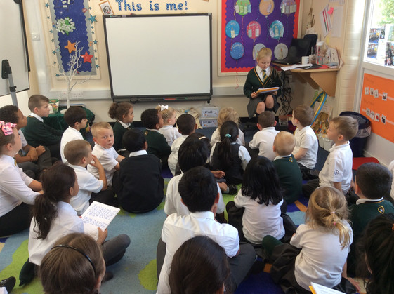 Story time with Reception and Y4!
