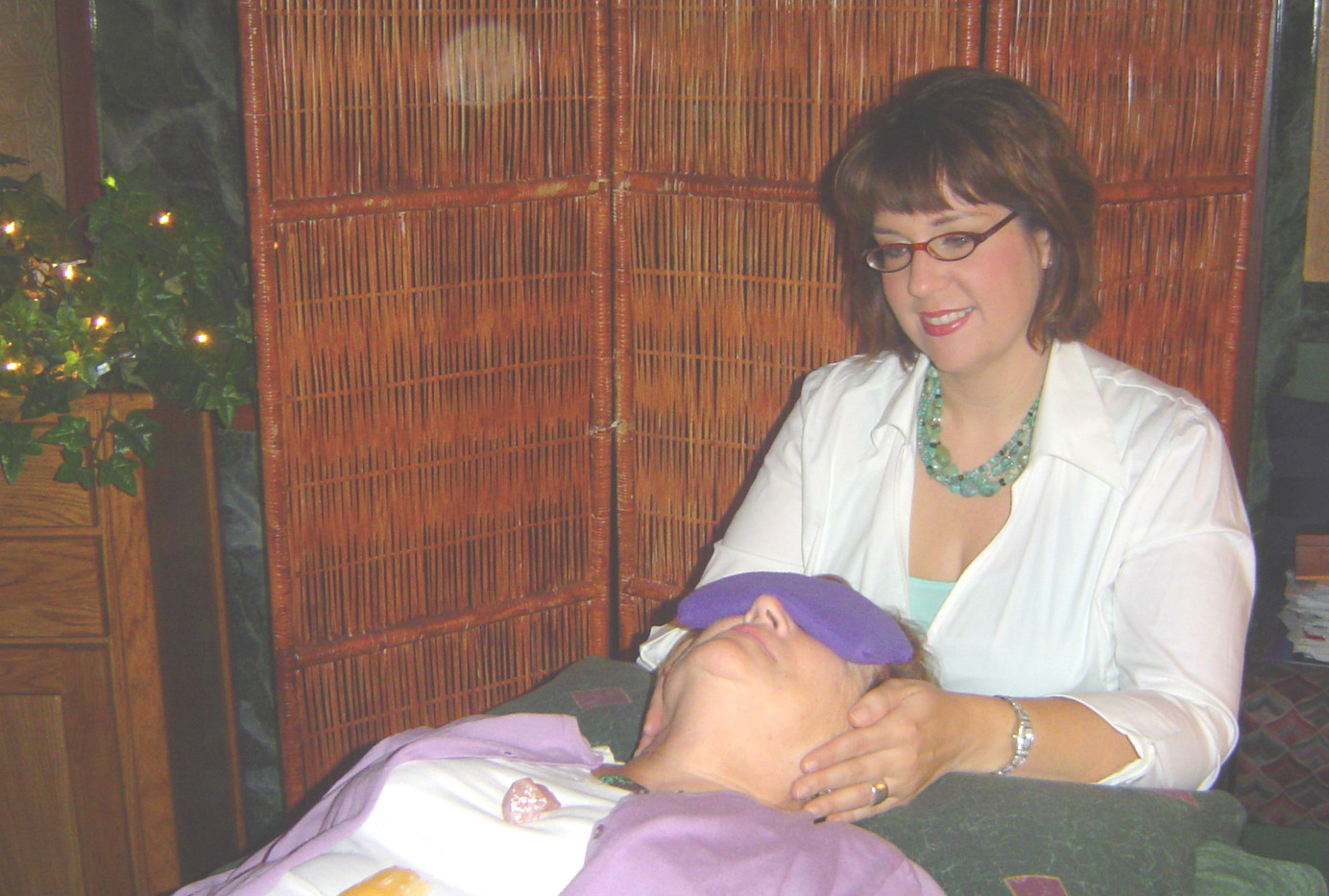 Giving my mom Reiki for the newspaper