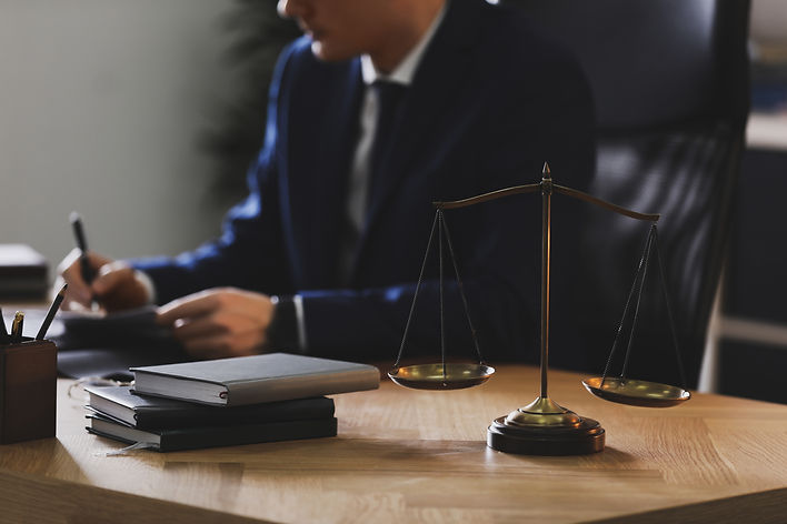 Male lawyer working at table in office,