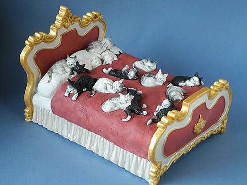 Cats on a Bed