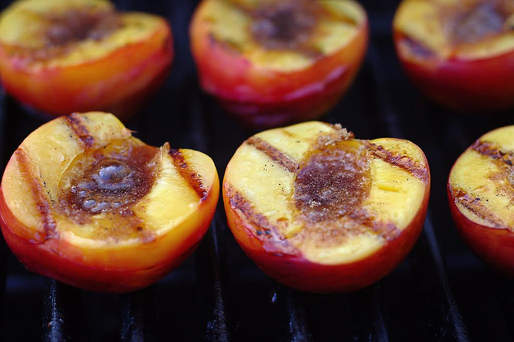 Peaches that have been grilled.