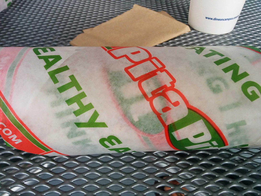 Pita wrapped in Pita Pit wrapping.