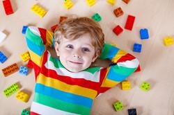 bigstock-Little-Blond-Child-Playing-Wit-