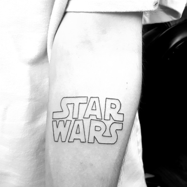 Hand Poked Star Wars Logo Tattoo