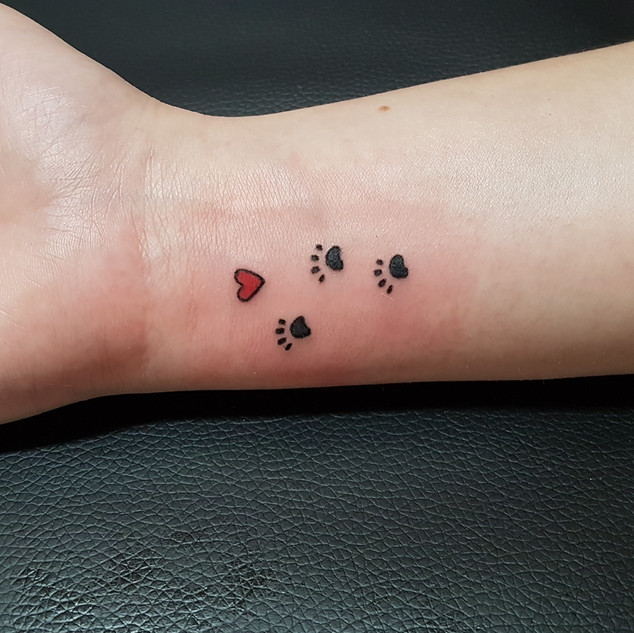 Hand Poked - Three paw and heart tattoo