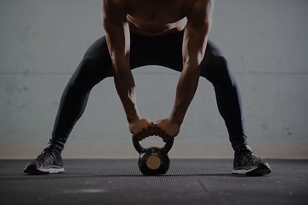 Muscular%2520Man%2520Lifting%2520Kettle%