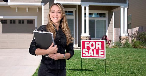 woman-agent-realtor-standing-outside-hom