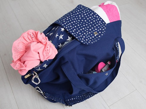 Big bag in blue and silver packed for family swim, a great big family bag