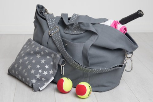 Big bag full of tennis gear, a great big gym/exercise bag with small star print bag