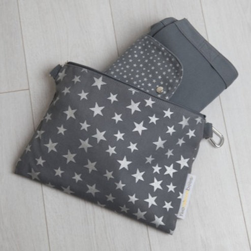 Big bag folds away into small star print cross body bag in grey and silver star print