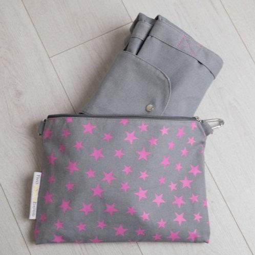 Big foldaway travel bag in small star print bag in grey and neon pink