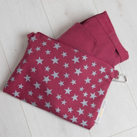 Big bag folds away into star print bag in maroon and grey