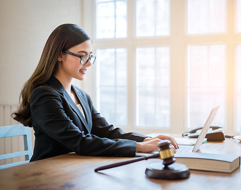 Legal professional working on computer