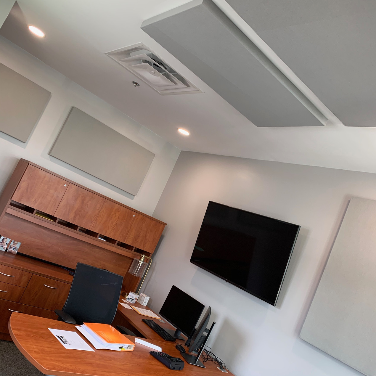 They can be placed anywhere to correct reverb in a large service center or office (as pictured).  In this case the service technicians could not understand or hear the clients on the other side of the desk when coming in for service on their car.  In the office, the reverb from a large dealership, created an unworkable space.  After calculating the size of the room and reverb, a design could begin to take shape of placement for reverb reduction and keeping with the clean lines and style of the new dealership via an array of color selections that are available.  Not only has the reverb been reduced and clarity increased, there is a new speed in processing requests.  So next time you are thinking of a solution that creates speed with look, Think Sound Proof Atlanta, Custom Soundproofing Authorities.