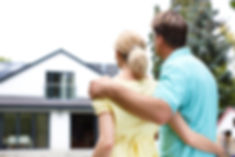 young-couple-looking-at-house-buying-a-h