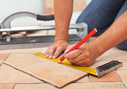 person-with-ruler-installing-tile-floor.