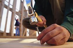 hitting-nail-into-wooden-beam-86079876-5
