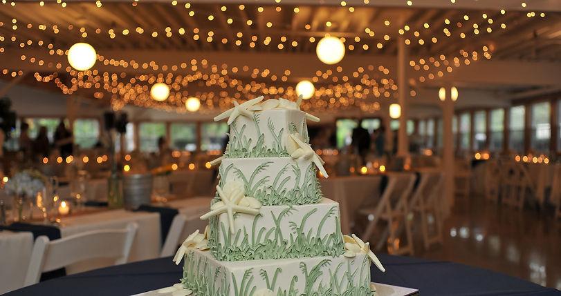 Beach themed white wedding cake decorated with starfish