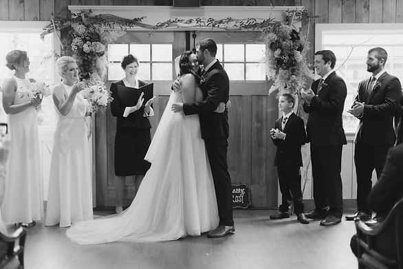 Black and white picture of bride, groom and guests in the York Rooom at Fosters Clambakes and Catering in York, Maine