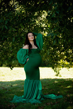 pregant lady wearing green outside