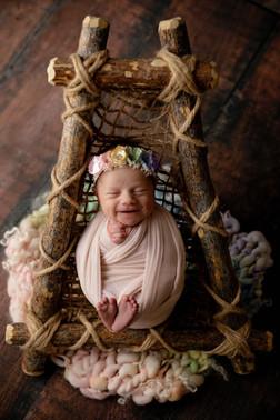 Smiling rainbow newborn
