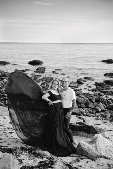 engaged couple on a rocky beach at harkness memorial state park