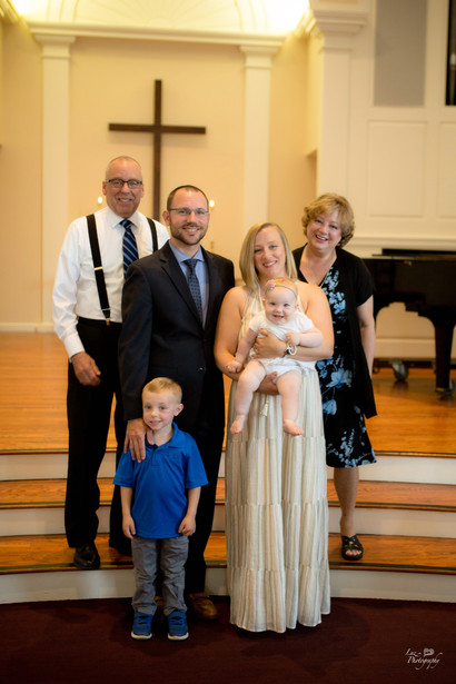 family of four baptism at church