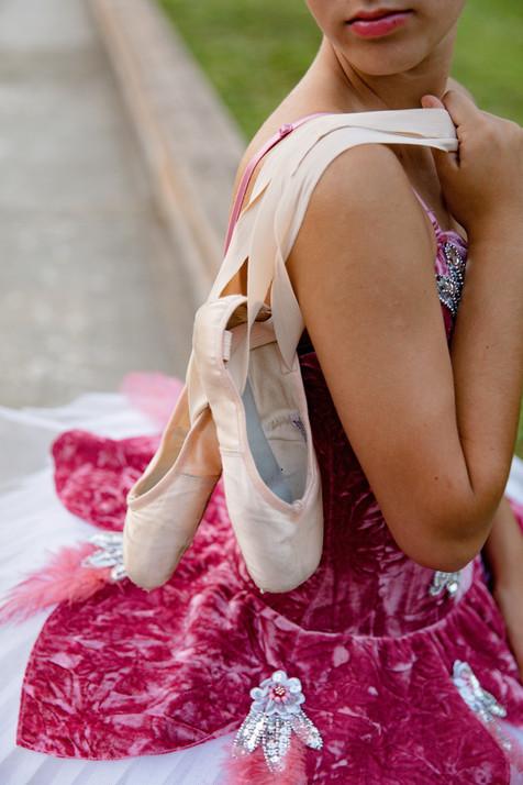 Girl holding ballerina shoes