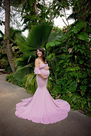 pregnant woman in mauve maternity dress in tropical setting