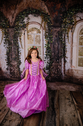 young girl in pink dress in old mansion scene