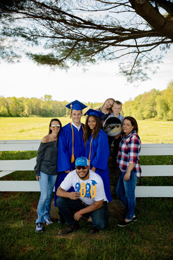 2020 graduation family in front of a field