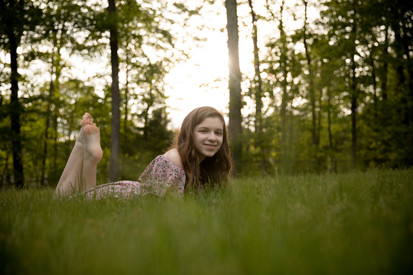Teen laying in grass