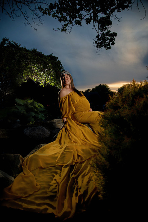 pregnant mom in gold flowing Maternity just after sunset