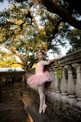 little girl dressed as a ballerina outside