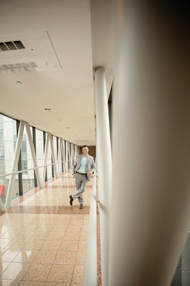 business photoshoot with man at end of hallway