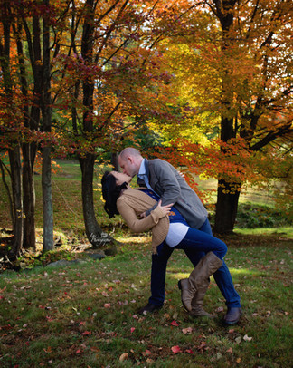 Married couple dip kiss in the fall