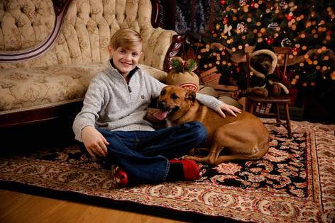 boy with brown dog christmas