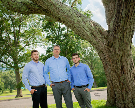 father and two sons outside
