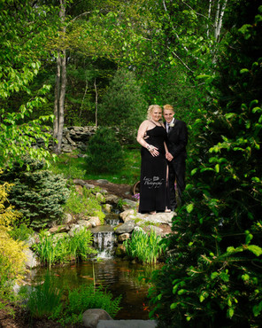 prom couple on the edge of a small pond