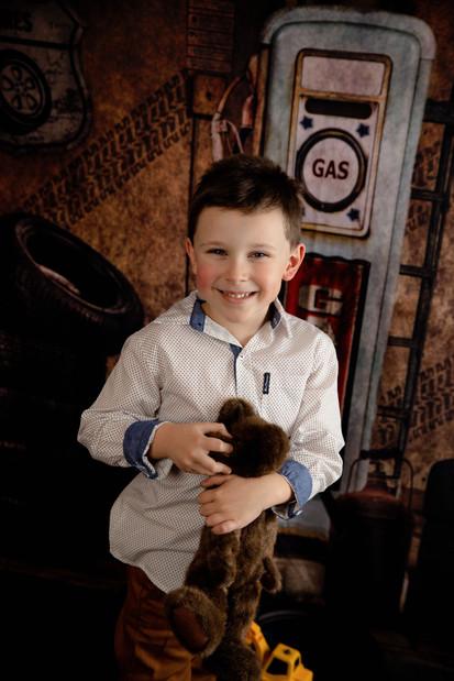 Boy holding a stuffed bear